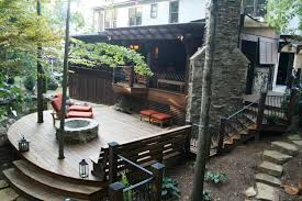 decksouth curved hardwood deck with firepit stone fireplace bench