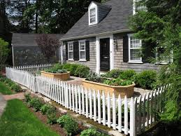 raised garden beds with fence landscape traditional with cape cod