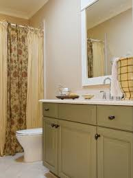 single vanity bathroom with sage green cabinets this bathroom from