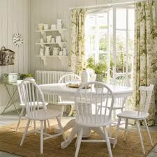 country dining room with toile curtains and white furniture