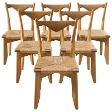 guillerme and chambron set of six dining chairs in oak and woven