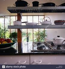 modern kitchen open shelving modern kitchen with black and white enamel pans on open shelves