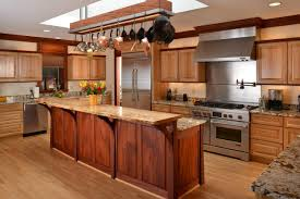 kitchen island custom pot rack stained wood panel cabinetry