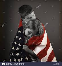 Black Flag Family Two Children Are Hugging An American Flag In Color For An American