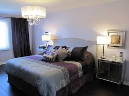 bed design with side table dark and grey bedroom design with classic iron chandelier plus