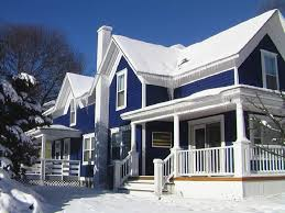 exterior american look of blue wall paint mix white fence and