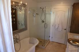 Bathrooms With Freestanding Tubs by Rectangle Glass Shower Areas With Grey Shower Bench On White