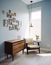 the home office is furnished with a vintage hans wegner armchair