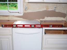 how to level kitchen base cabinets how to install a granite kitchen countertop how tos diy