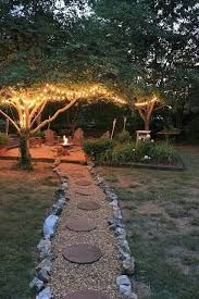 how to light a fire pit light stringers to illuminate your fire pit area backyardgoals