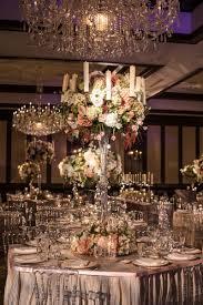 reception décor photos tall floral centerpieces with candles