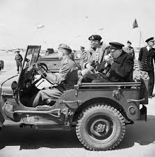 black military jeep file winston churchill lights a cigar in the back of a jeep while