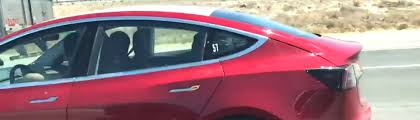 tesla inside roof tesla model 3 spotted with camouflaged roof what might be cooking