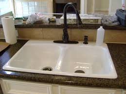 installing new kitchen sink kitchen sink decoration to replace a kitchen sink and with white cabinets and dark granite she decided to switch from a stainless sink and faucet to a nice white kohler