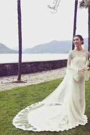 batman wedding dress model and batman tao okamoto is married wwd