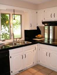 black and white appliance reno black appliances white cabinets light gray backsplash see more
