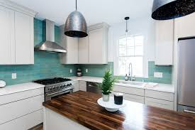 kitchen with white cabinets and wood countertops wood kitchen countertops to inspire your next remodel