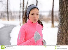 asian headband asian woman running in winter gloves and headband stock photo
