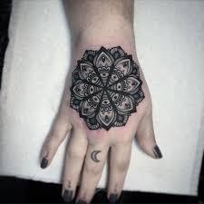 mandala hand tattoo by flo nuttall tattoomagz