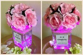 light up floral centerpiece with glass vase and custom label