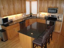 kitchen brown wooden flooring brown kitchen islands black