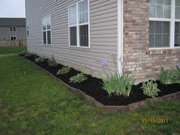 black mulch landscaping we used rectangular pavers along with