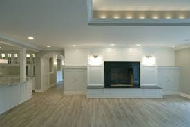 unfinished basement remodeling ideas with brick wall fireplace and