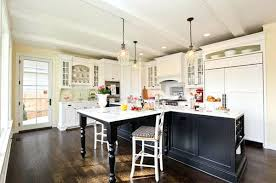white kitchen cabinets with black island black kitchen with white center island cabinets top