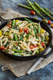 pesto chicken pasta skillet with asparagus and tomatoes country