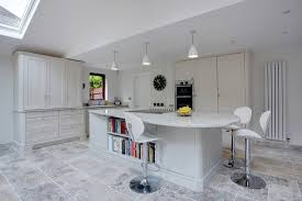 interior white wood cabinets with colonial white granite and