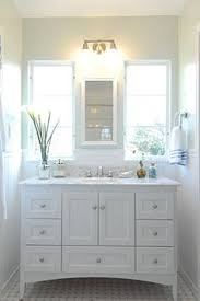 How To Make A Small Half Bathroom Look Bigger - windsong tour basement pt 1 navy cabinets studio mcgee and