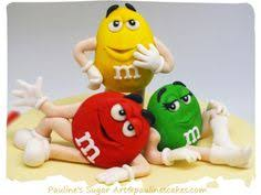 m m cake toppers m m green posing in daffodil flowers m m candy characters
