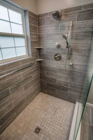 best 25 wood tile bathrooms ideas on pinterest wood tile shower i do like the wood look maybe can do partial bottom wood hering bone middle and then wood tile again at top with light color stone or these lil squares