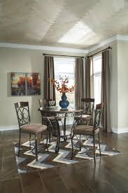 signature design by glambrey round dining table and 4 chair