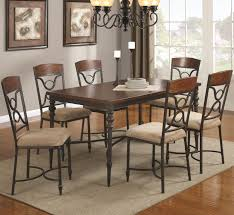awesome metal dining table for fancy dining space setups ruchi astounding design of the metal dining table with brown wooden color ideas added with grey rugs