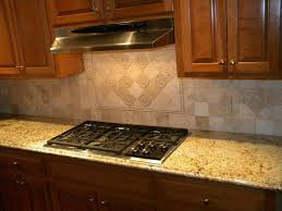 tumbled marble kitchen backsplash kitchen using gas range and granite countertops with