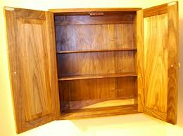 cabinet with shelves and doors walnut cabinet with shelves and raised panel doors the apprentice