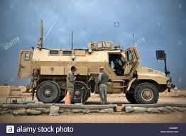 mrap u s army sergeant refuels a caiman mrap vehicle iraq stock photo