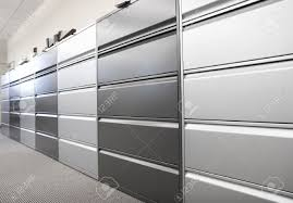 large filing cabinets cheap long row of large filing cabinets in an office or hospital stock