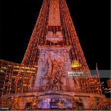 soldiers and sailors monument illuminated with tree