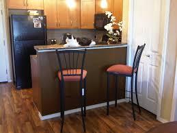 furniture brown wooden kitchen cabinet and black refrigerator on
