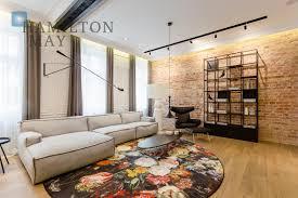 luxurious designer soft loft apartment in a prewar townhouse