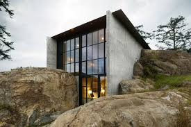 this sleek aia winning home was built between two rocks curbed