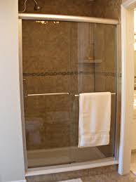 fresh dark marble wall panels with sliding curved glass shower