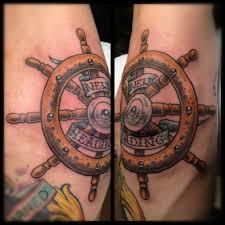 weird ship wheel elbow tattoo design for boys picsmine