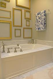 hot trend 30 creative ways to decorate with empty frames empty frames add golden glint to the shabby chic style bathroom from sarah