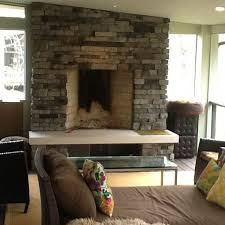 stone fireplace on outdoor living space archadeck outdoor living