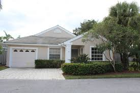 homes for sale in pga national palm beach gardens with image of