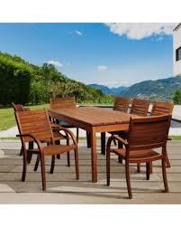 eucalyptus wood dining table deal alert 20 off amazonia lourdes 9 piece eucalyptus wood outdoor