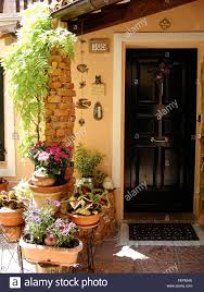 Home Courtyards Home Various Flowers In Pots Design Italian Courtyards Stock